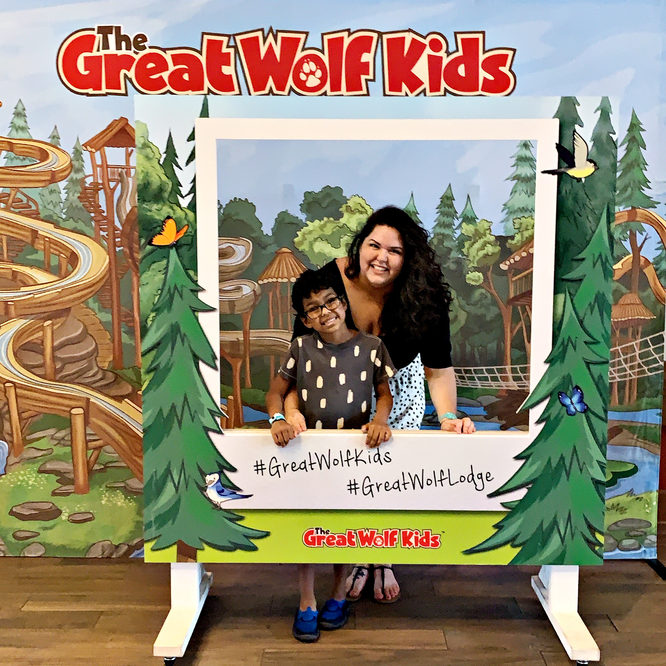 Mom and son at Great Wolf Lodge in Atlanta/LaGrange, posing in the Great Wolf Kids polaroid photobooth op.