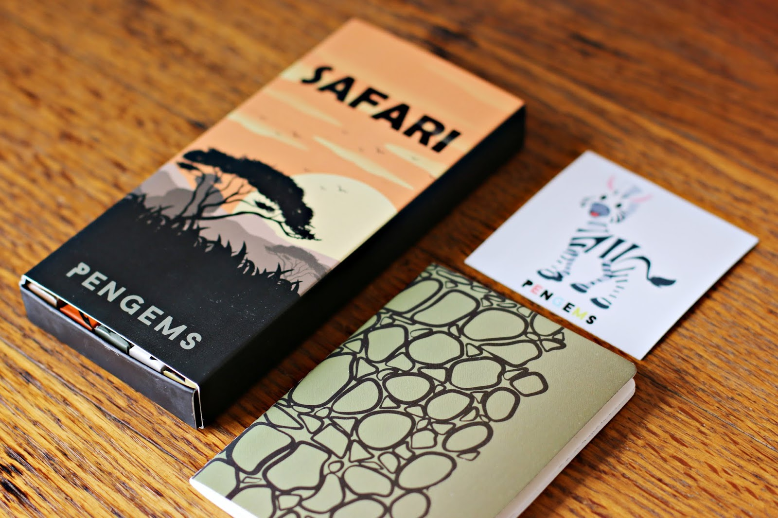 PenGems Safari Collection -- this shows the collection box, a sticker of a zebra and a small notebook