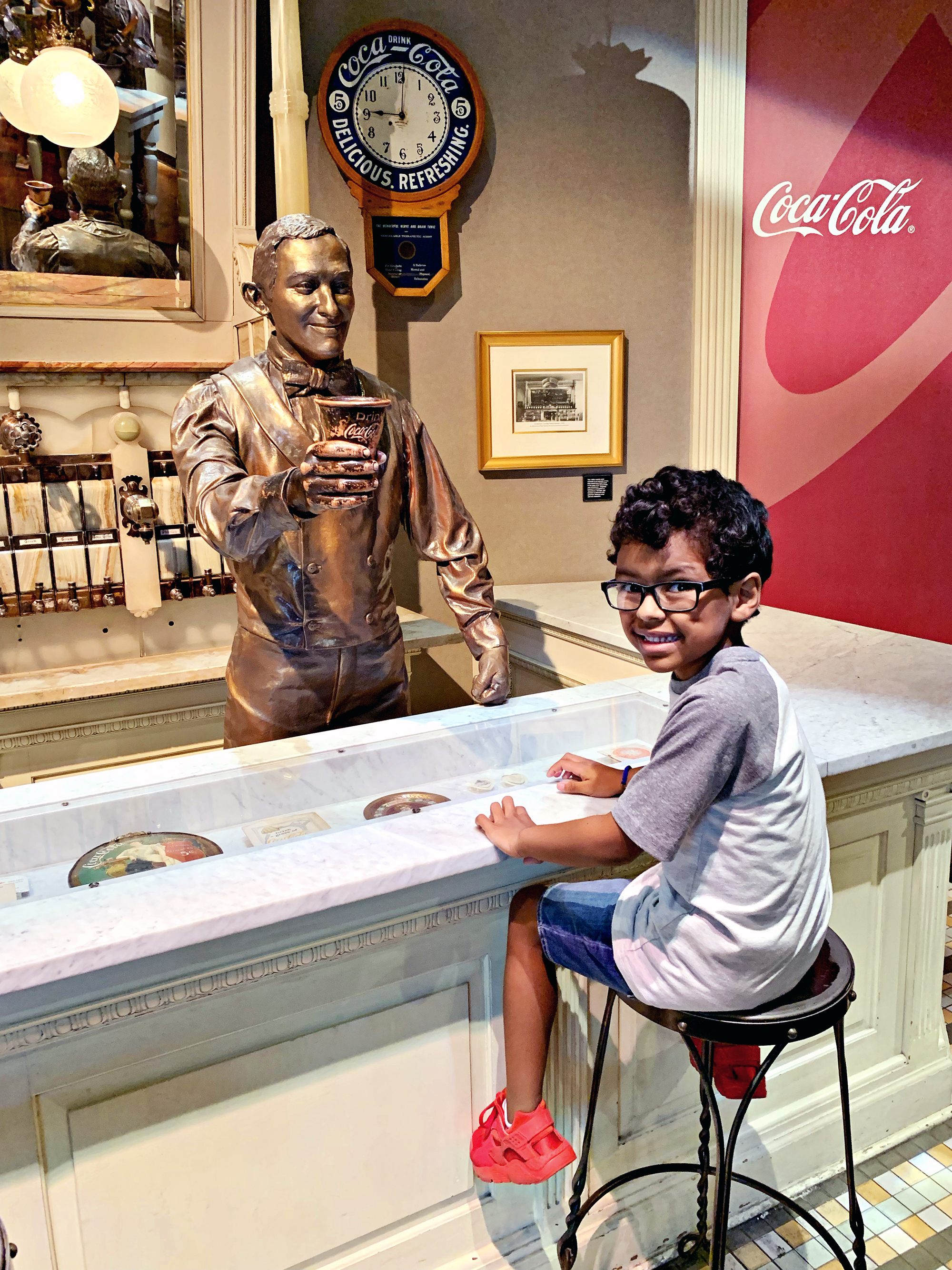 Kids will think its fun to sit at an old soda fountain at World of Coa-Cola