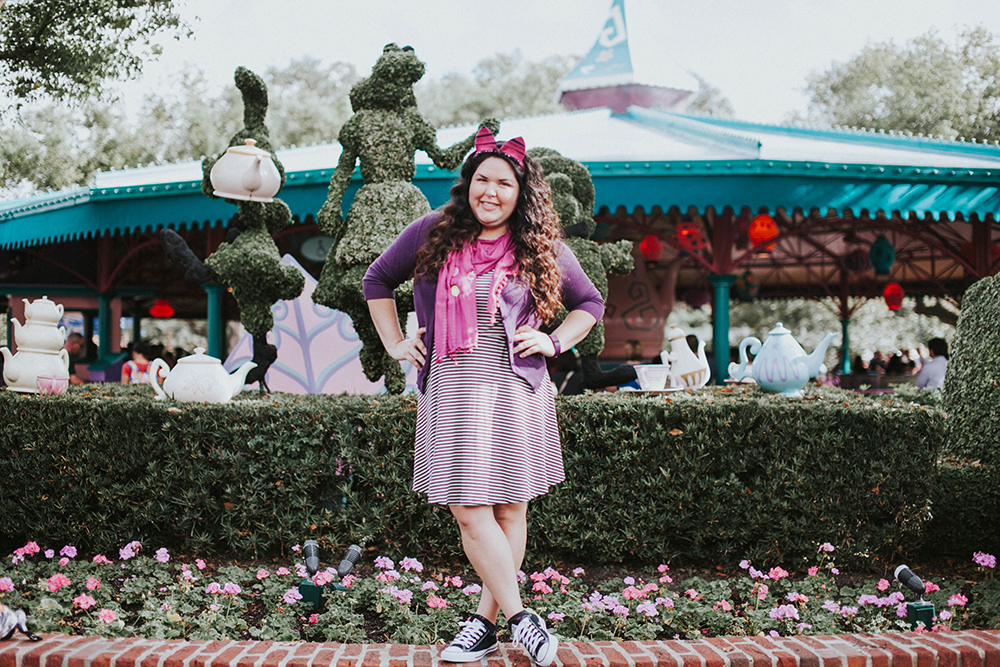 Woman posing in her Disneybound outfit as Cheshire Cat.