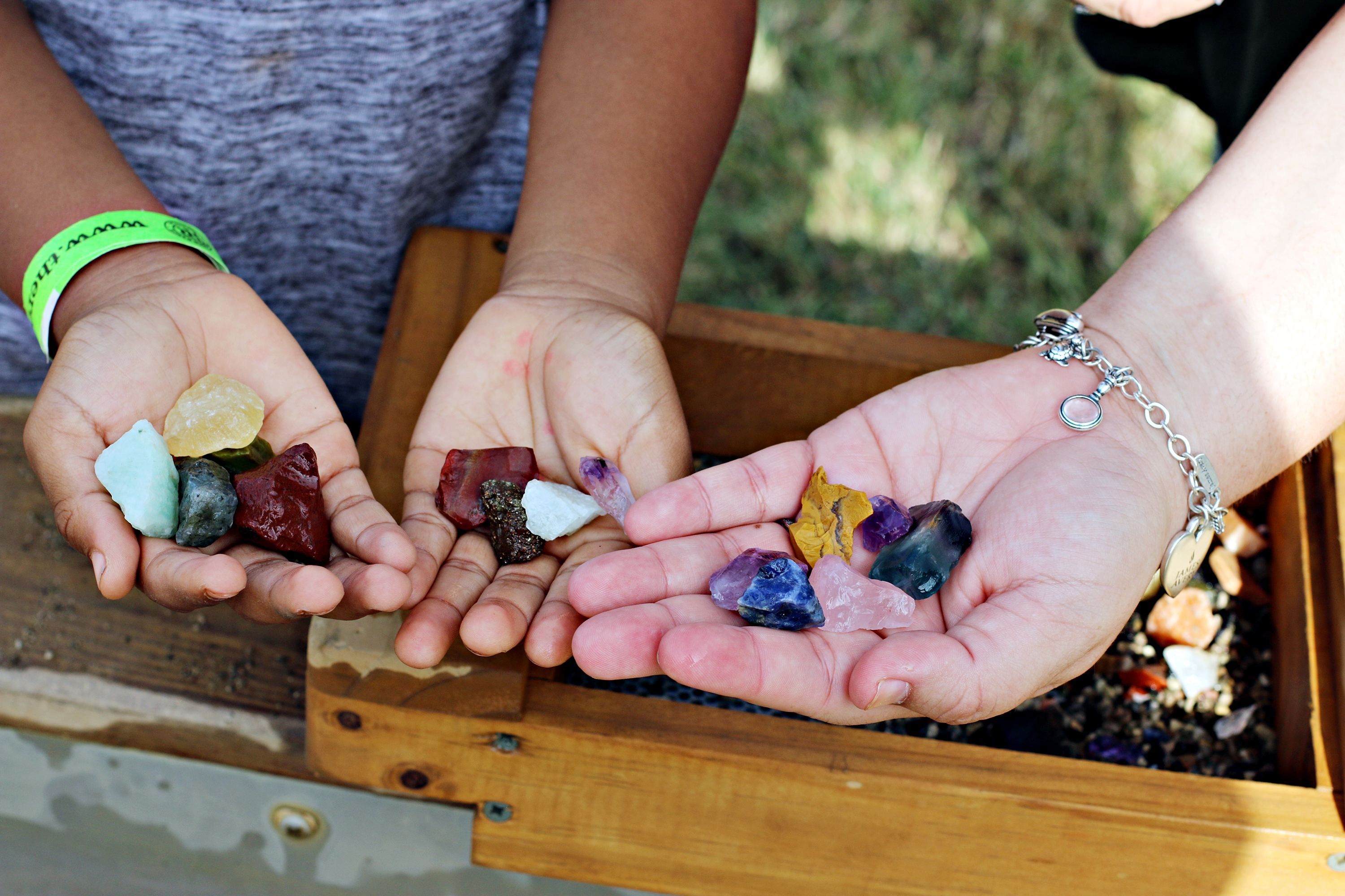 Boy and mom holding gemstones they've mined at The Rock Ranch.