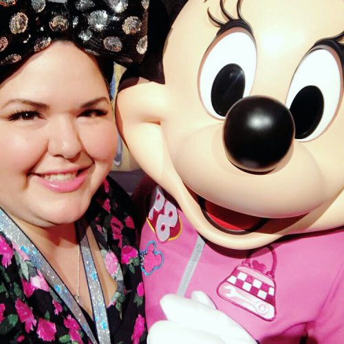 A close up selfie of a woman in Minnie ears with Minnie Mouse.