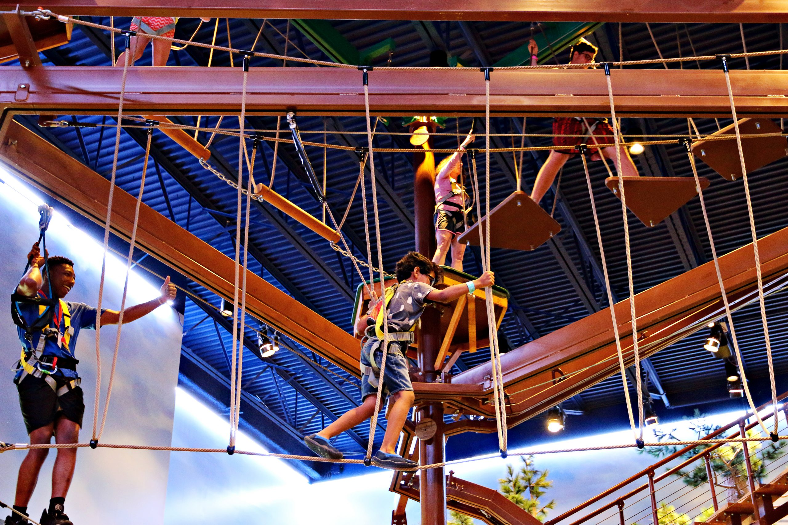 Boy climbing a rope course at Great Wolf Lodge Atlanta in LaGrange, Georgia.