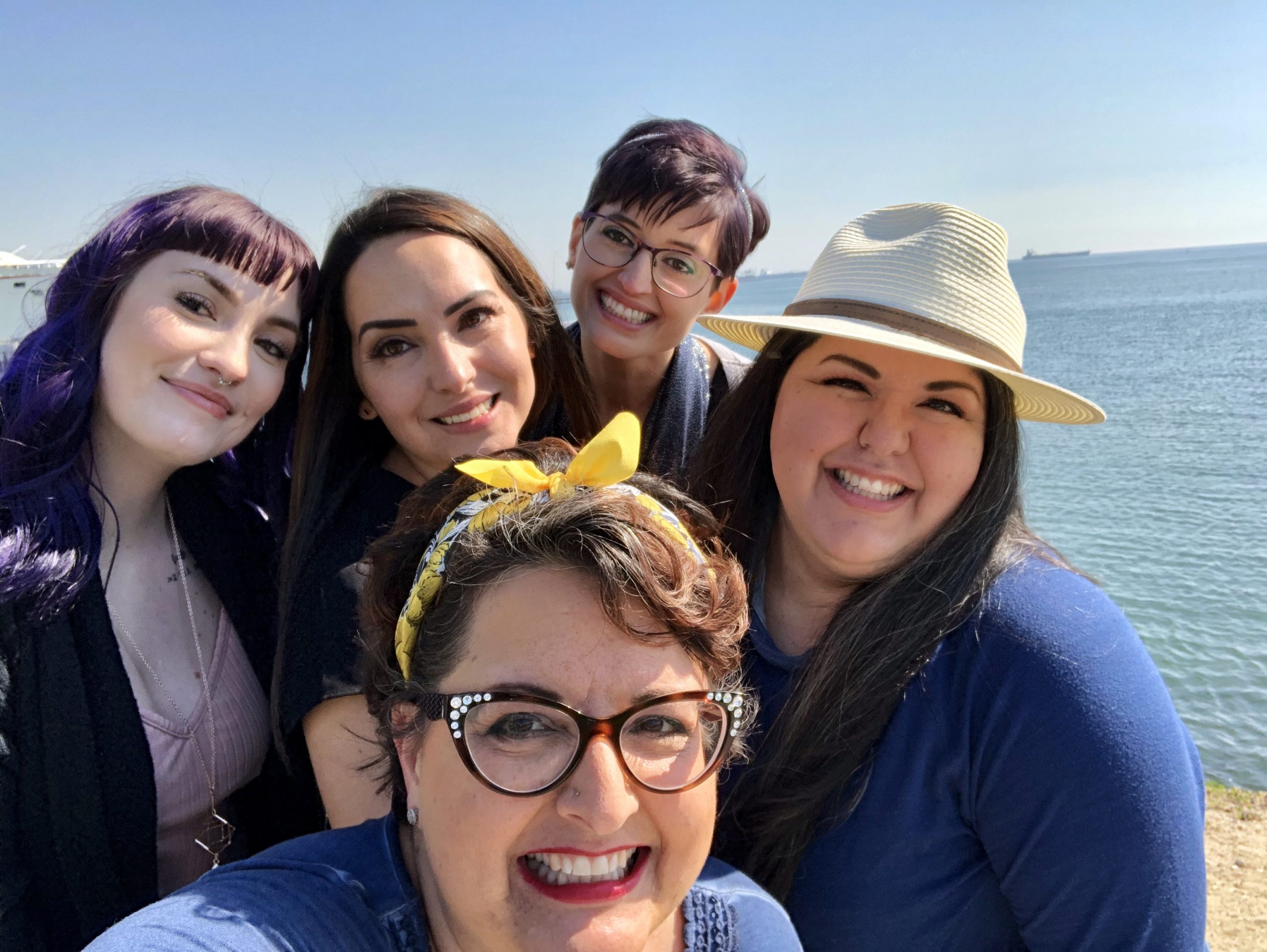Selfie with four sisters and their mom in front, smiling in Long Beach.